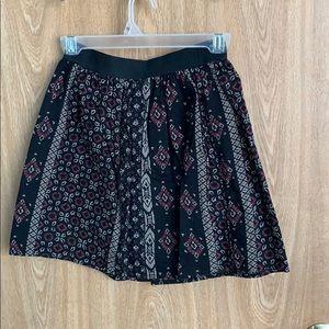 Adorable black patterned skirt.